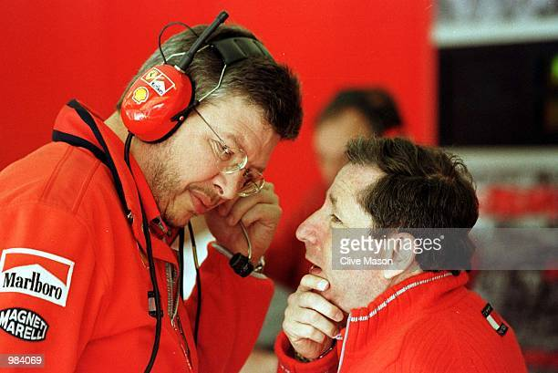 Ferrari team boss John Todt chats with Ross Brawn in the garage during the First free practice session for the Spanish Grand Prix at the Circuit de...