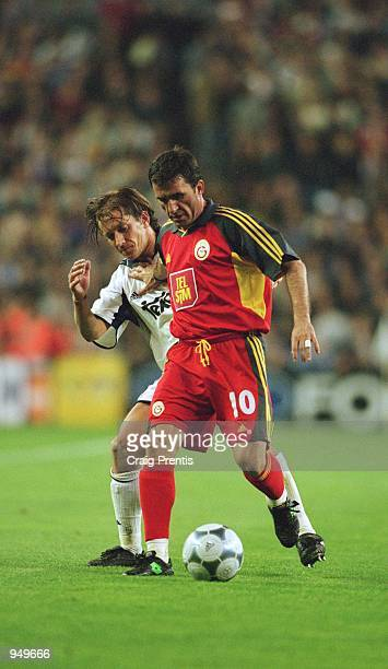 Gheorghe Hagi of Galatasaray holds the ball up against Michel Salgado of Real Madrid during the UEFA Champions League Quarter Finals second leg match...