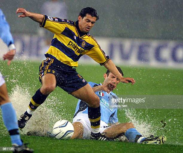 Giuseppe Favalli of Lazio and Sergio Conceicao of Parma in action before the suspension of the Serie A 25th Round League match between Lazio and...