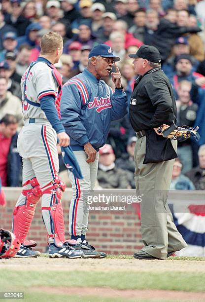 Head Coach Felipe Alou and Michael Barrett of the Montreal Expos discuss a questionable call with Umpire Rick Reed during the Opening Day game...