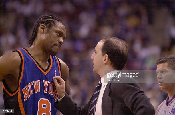 Head coach Jeff Van Gundy of the New York Knicks instructs Latrell Sprewell in game three of the NBA Playoffs against the Toronto Raptors at the Air...