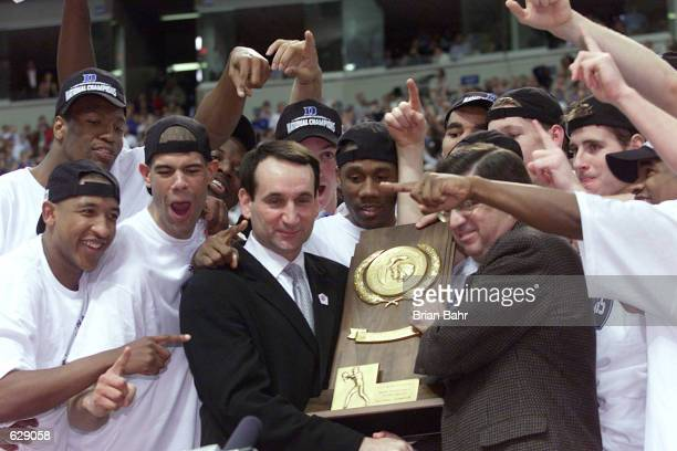 Head coach Mike Krzyzewski of Duke is awarded with the trophy after defeating Arizona 8272 in the NCAA National Championship Game of the Men's Final...