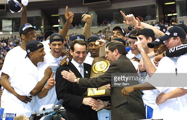 Head coach Mike Krzyzewski of Duke is presented with the trophy after defeating Arizona 82-72 in the NCAA National Championship Game of the Men's...