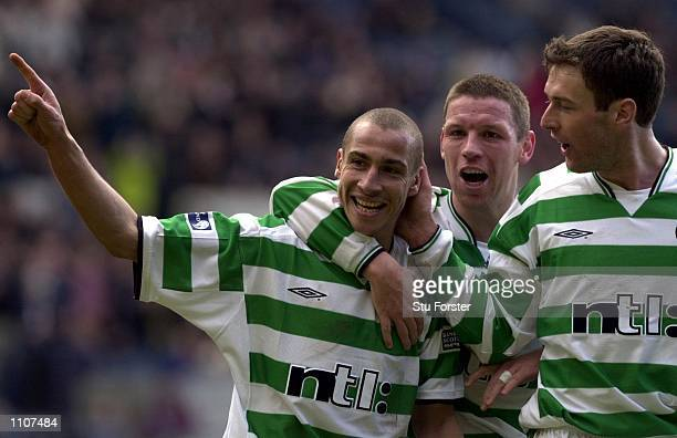 Henrik Larsson celebrates with team mates Alan Thompson and Chris Sutton after giving Celtic a twonil lead during the Semi Final of the Tennents...