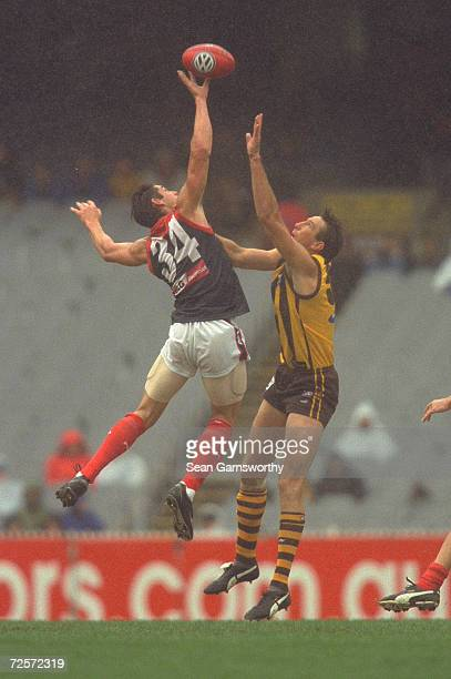 Jeff White for Melbourne contests the ruck against Shaun Rehn for Hawthorn in the match between the Hawthorn Hawks and the Melbourne Demons played at...