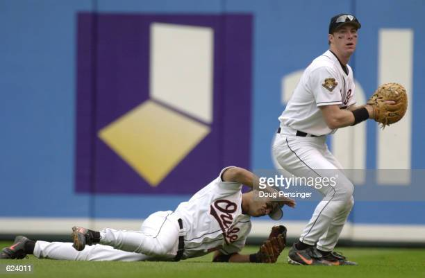 Jerry Hairston of the Baltimore Orioles slaps the ground in disgust after diving and missing a line drive as Chris Richard collects the ball against...