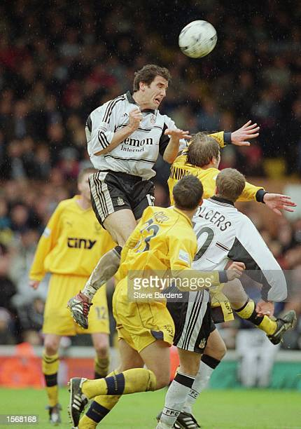 Karl Heinz Riedle of Fulham jumps highest during the Nationwide League Division One match against Wimbledon played at Craven Cottage in London The...