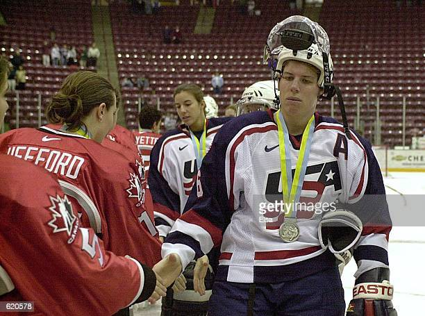 Karyn Bye of the USA shakes hands with Team Canada players after Canada won the Women's World Hockey Championships at Mariucci Arena in Minneapolis,...