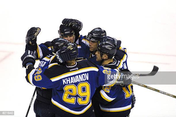 Keith Tkachuk of the St Louis Blues celebrates his goal with teammates against the San Jose Sharks during game 4 of the Western Conference Playoff...