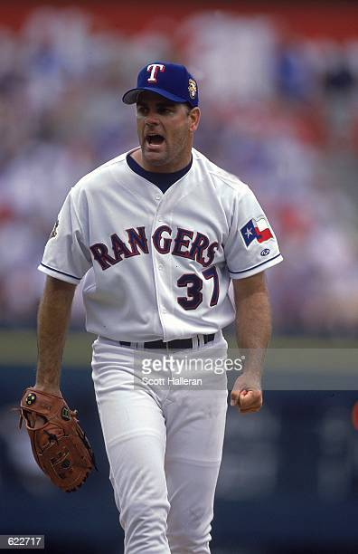 Kenny Rogers of the Texas Rangers cheers during the game against the Anaheim Angels at The Ballpark in Arlington Texas The Rangers defeated the...