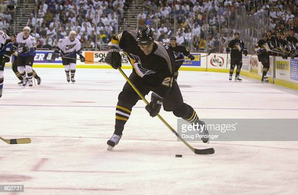 Kevin Stevens of the Pittsburgh Penguins takes a shot against the Washington Capitals during Game 5 of the Eastern Conference Quarterfinals of the...