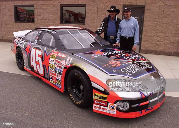 Kyle and Richard Petty pose after the unveiling of the new Petty Enterprises petty charity Ride Dodge Intrepid R/T during practice for the NAPA Auto...