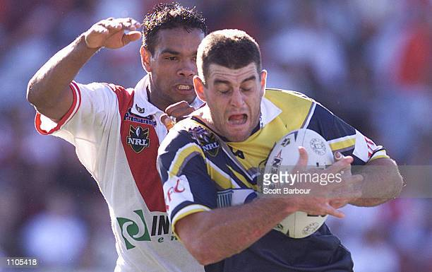 Kyle Warren of the Cowboys is tackled during the round 7 NRL match between the St George Illawara Dragons and the North Queensland Cowboys played at...