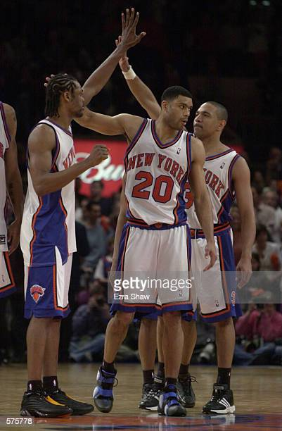 Latrell Sprewell Marcus Camby and Mark Jackson of the New York Knicks celebrate a victory over the Toronto Raptors at the end of game 1 of round one...