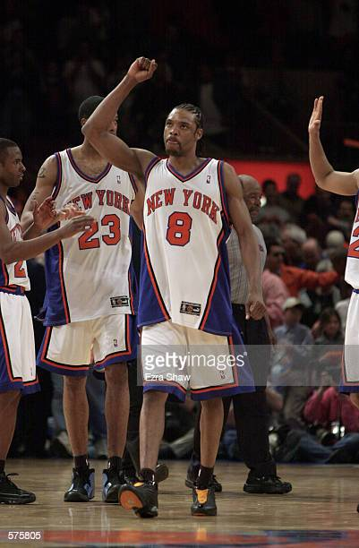 Latrell Sprewell of the New York Knicks celebrates a victory over the Toronto Raptors at the end of game 1 of round one in the NBA Playoffs at...