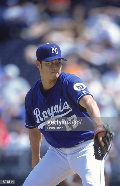 Mac Suzuki of the Kansas City Royals starts to pitch during the game against the Minnesota Twins at the Kauffman Stadium in Kansas City Missouri The...
