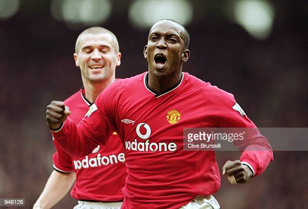 Manchester United goal scorer Dwight Yorke celebrates with team mate Roy Keane during the FA Carling Premiership match against Coventry City at Old...