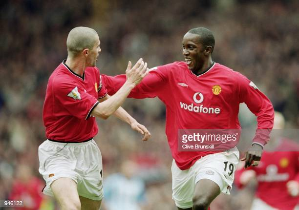 Manchester United goal scorer Dwight Yorke is congratulated by team mate Roy Keane during the FA Carling Premiership match against Coventry City at...
