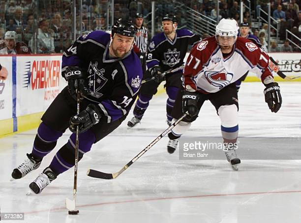 Mattias Norstrom of Los Angeles Kings skates past Ray Bourque of the Colorado Avalanche in the third period of their Western Conference semifinal...