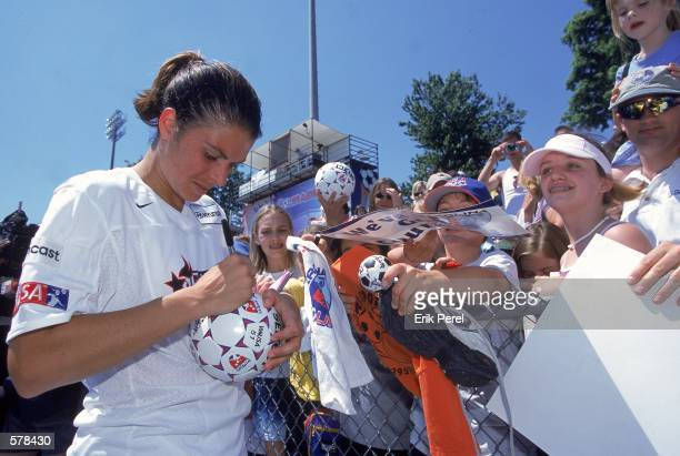 Mia Hamm of the Washington Freedom signs a soccer ball for a fan before the WUSA game against the Carolina Courage at Fetzer Field in Chaple Hill...