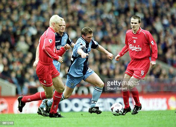 Michael Simpson of Wycombe gets past Sami Hyypia of Liverpool during the AXA FA Cup Semi Final between Liverpool and Wycombe Wanderers at Villa Park...
