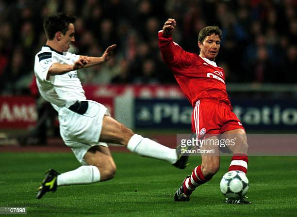 Michael Tarnat of Bayern Munich puts in the cross for Giovane Elber to score the first goal during the match between Bayern Munich and Manchester...