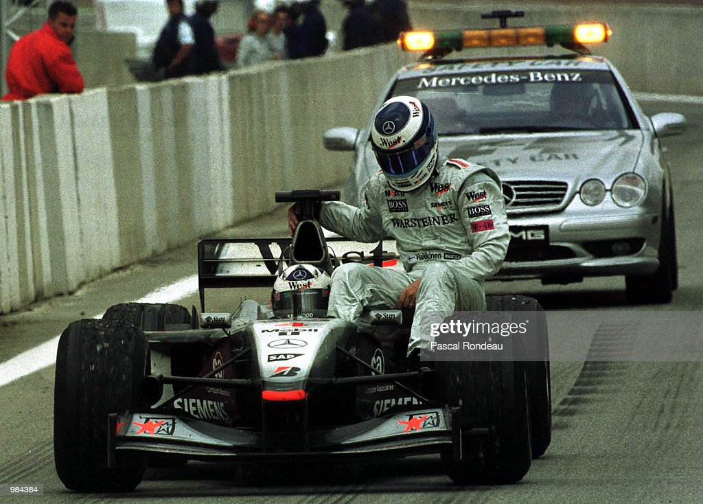 Mika Hakkinen of McLaren and Finland rides back to the paddock on his team mate David Coulthard's car after an engine blow during the Spanish Formula One Grand Prix at the Circuit de Catalunya, Barcelona, Spain. Mandatory Credit: Pascal Rondeau/ALLSPORT