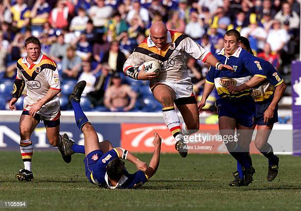 Paul Anderson of Bradford beats the Warrington defence during the Silk Cut Challenge Cup SemiFinal between the Warrington Wolves and Bradford Bulls...