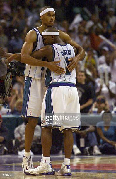 PJ Brown of the Charlotte Hornets gets a hug from Baron Davis after the second half against the Miami Heat in Game 3 during the First Round of the...