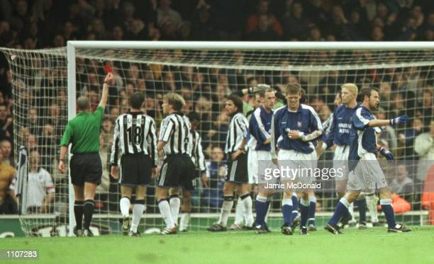 Referee Mike Dean shows Newcastle's Nol Solano the red card during the FA Carling Premiership game between Ipswich Town v Newcastle United at Portman...