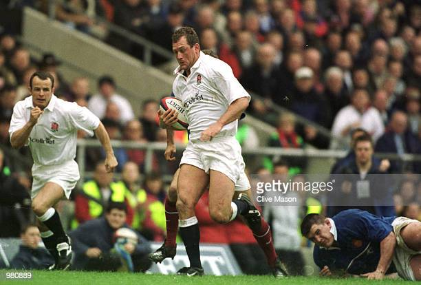 Richard Hill of England breaks the line to score a try during the Six Nations match between England and France played at Twickenham in London...