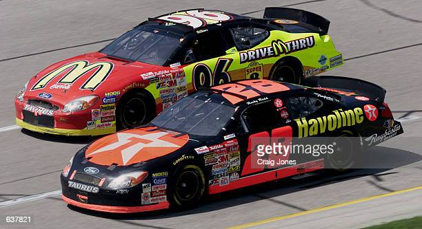 Ricky Rudd in the Robert Yates Racing TexacoHavoline Ford dices with the Ford of Andy Houston during the NASCAR Winston Cup Talladega 500 at the...