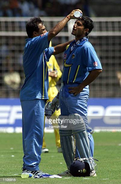 Robin Singh of India pours water over team mate Saurav Ganguly during the 5th One Day International between India and Australia at the Nehru Stadium...