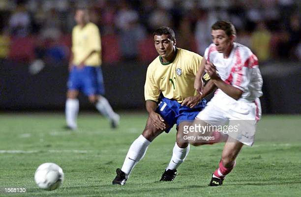 Romario of Brasil left and Rebosio of Peru in action during the Brasil v Peru match played at the Morumbi Stadium Sao Paulo Brazil DIGITAL IMAGE...