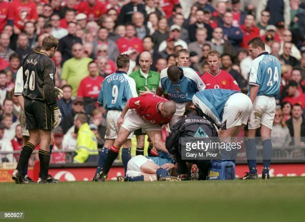 Roy Keane of Manchester United shouts at Alf Inge Haaland of Manchester City following his red card during the FA Carling Premiership match played at...