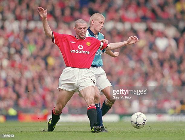 Roy Keane of Manchester United tussles with Alf Inge Haaland of Manchester City during the FA Carling Premiership match played at Old Trafford in...