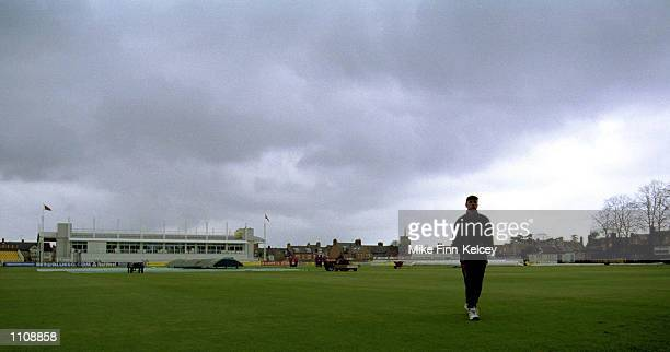 Russell Warren of Northamptonshire wanders back to the pavilion after play was delayed by overnight rain the CricInfo Championship match against...