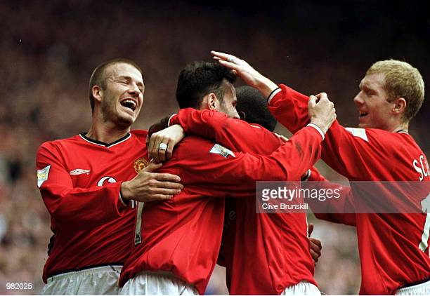 Ryan Giggs of Man Utd celebrates with David Beckham Dwight Yorke and Paul Scholes after scoring the third goal during the Manchester United v...