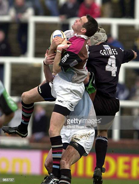 Ryan O''Neill the Harlequins fullback catches the ball as Stuart Grimes of Newcastle challenges in the Newcastle v Harlequins European Shield match...