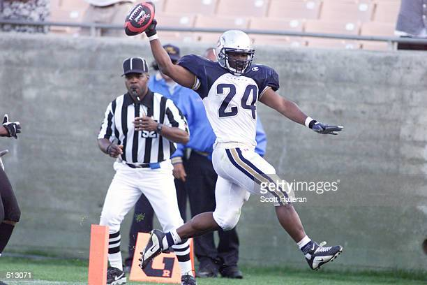 Saladin McCullough of the Los Angeles Xtreme runs for a touchdown against the Chicago Enforcers at Memorial Coliseum in Los Angeles California...