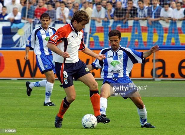Sandro of Malaga and Tomic of Oviedo in action during a Primera Liga match played between Malaga and Oviedo at the La Rosaleda Stadium DIGITAL IMAGE...
