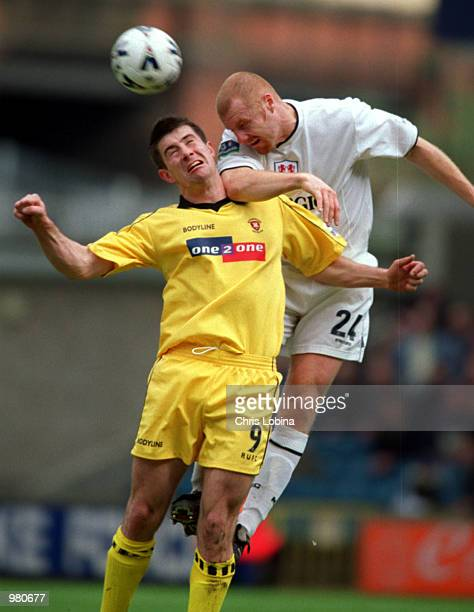 Sean Dyche of Millwall and Alan Lee of Rotherham in action during the Millwall v Rotherham United Nationwide Second Division match played at The New...