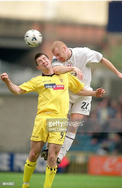 Sean Dyche of Millwall rises above Alan Lee of Rotherham United to head from danger during the Nationwide League Division Two match played at The New...