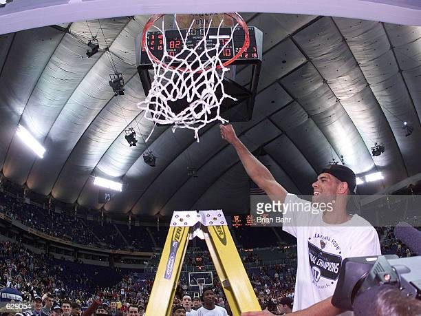 Shane Battier of Duke cuts down his portion of the net after defeating Arizona 82-72 in the NCAA National Championship Game of the Men's Final Four...
