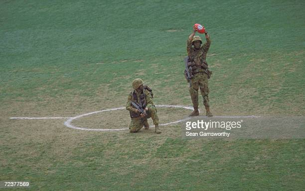 Soldiers deliver the match ball before the match between the Essendon Bombers and the Collingwood Magpies during round five of the AFL season on...