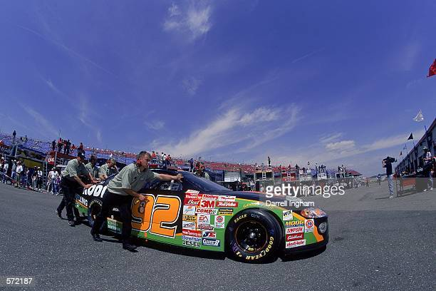 Stacy Compton who drives the Dodge Intrepid for Melling Racing is pushed by his team during the Talladega 500 presented by NAPA part of the NASCAR...