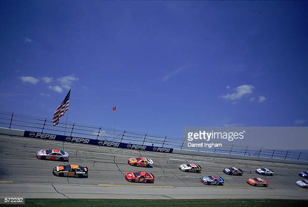 Stacy ComptonSterling Marlin Bill Elliott speed around the corner during the Talladega 500 presented by NAPA part of the NASCAR Winston Cup Series at...