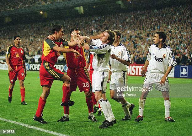 Steve McManaman of Real Madrid clashes with Galatasaray players Emre Asik and Akin Bulent during the UEFA Champions League Quarter Finals second leg...