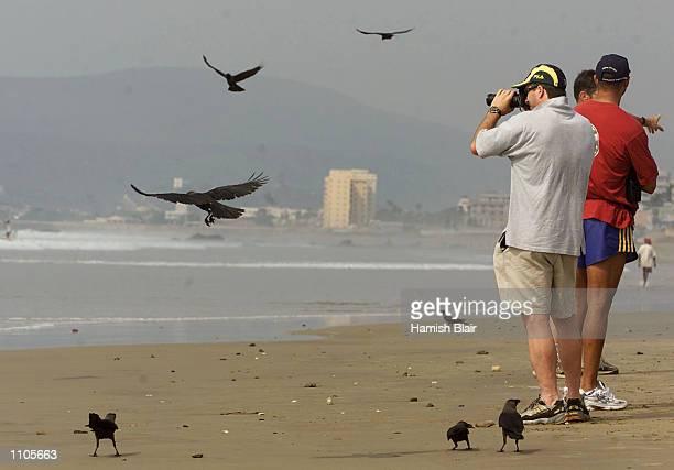 Steve Waugh of Australia takes a photograph on the beach in Vizag, India. X DIGITAL IMAGE Mandatory Credit: Hamish Blair/ALLSPORT