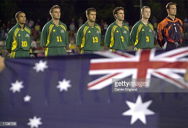 The Australian Socceroos line up for the national anthem before the Oceania group one World Cup qualifier match between Australia and American Samoa...
